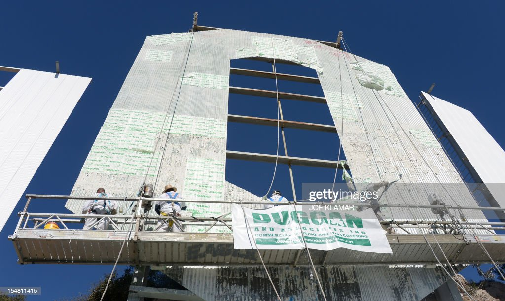 Workers use window-cleaner style platforms as they strip down the 50-foot (15-meter) tall letters, power washing the corrugated iron and apply nearly 400 gallons of fresh paint while restoring the Hollywood sign on October 26,2012 in Hollywood, California. The iconic Hollywood sign overlooking Tinseltown is getting its biggest renovation for 35 years, to prepare it for its 90th birthday next year. The operation, which started earlier this month, will take 8-10 weeks to restore the sign to its bright white glory atop Mount Lee in the Hollywood Hills north of Los Angeles.