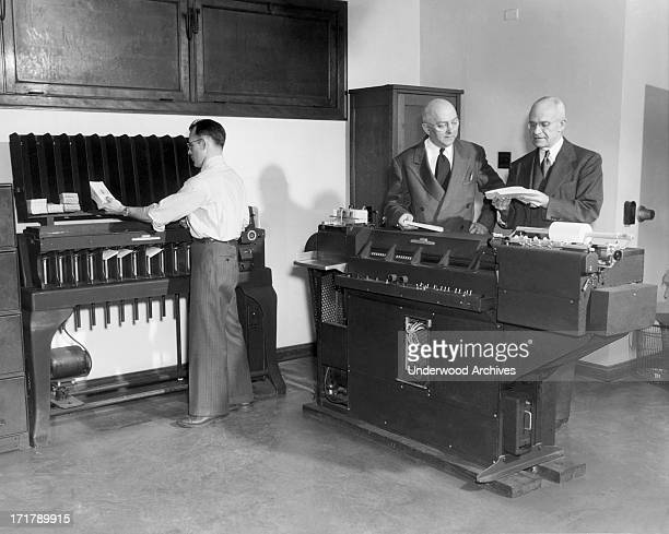 Workers using a punch card machine at the Erie Railroad offices Cleveland Ohio 1951