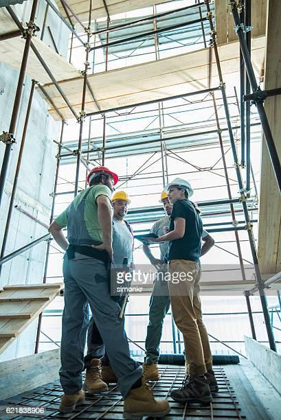 Workers using digital tablet