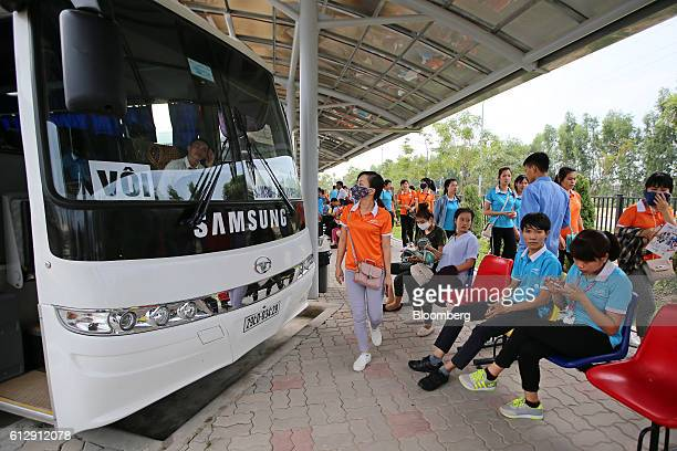 Workers wait for company buses at the Samsung Electronics Vietnam Co Plant at Yen Phong Industrial Park in Bac Ninh Province Vietnam on Thursday Sept...