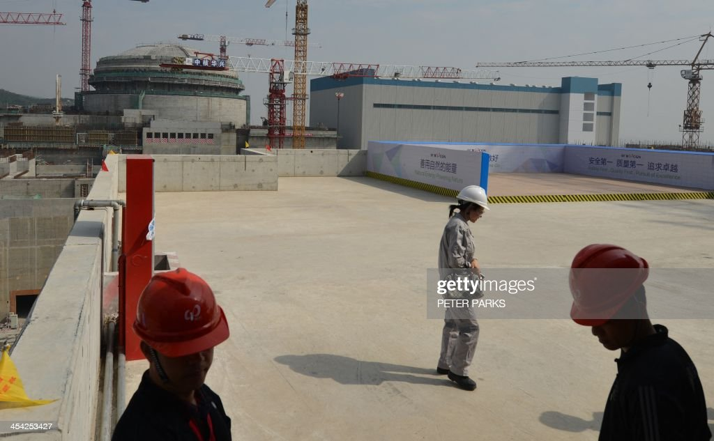 Workers wait for French Prime Minister JeanMarc Ayrault to arrive at the joint SinoFrench Taishan Nuclear Power Station outside Taishan City in...