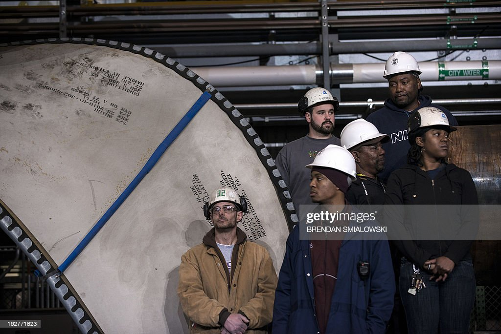 Workers wait for US President Barack Obama to speak during an event at Newport News Shipbuilding on February 26 2013 in Newport News Virginia Obama...