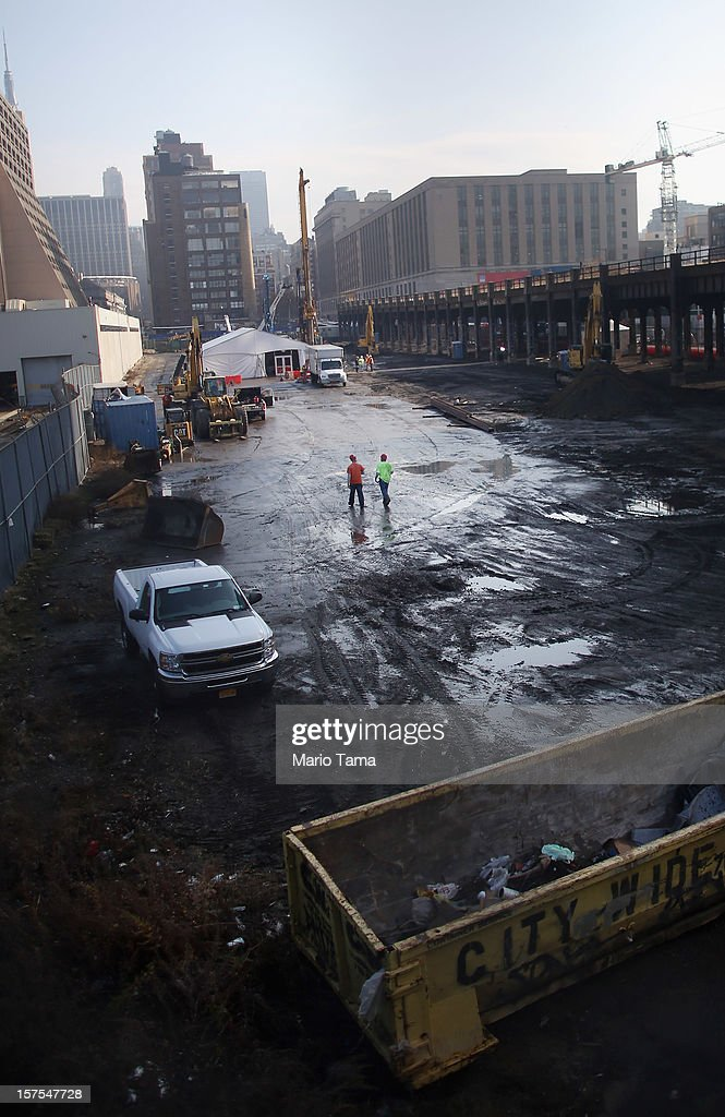 Workers walk after a groundbreaking ceremony for the Hudson Yards development at the site which is expected to boast 13 million square feet of residential and commercial space on a 26-acre site on Manhattan's west side on December 4, 2012 in New York City. The site was the largest undeveloped piece of property in Manhattan and is expected to create around 23,000 construction jobs. It will be the largest private development in the city since Rockefeller Center.