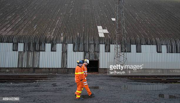 Workers walk alongside one of the storage silos at the potash facility at Tees Docks on November 20 2014 in Tees Docks United Kingdom Cleveland...