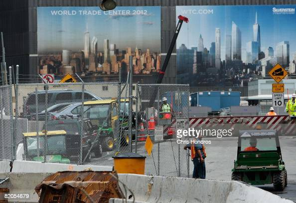 Workers walk around the construction site on the west side of the former World Trade Center site in the area near where St Nicholas Greek church once...
