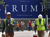 Workers walk away at the end of their shift from the site of the future Trump International Hotel which is at the location of the Old Post Office...
