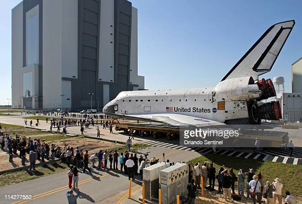 NASA workers walk in front of space shuttle Atlantis STS135 Tuesday May 17 a day after shuttle Endeavour STS134 launched on its final flight Atlantis...