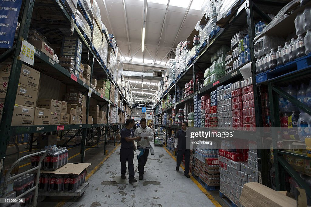 Workers walk in the warehouse of a Wal-Mart Stores Inc. location in Mexico City, Mexico, on Thursday, June 20, 2013. Mexican retail sales rose 2.5 percent in April from the same month last year, the country's statistics agency, known as Inegi, reported on its website. Photographer: Susana Gonzalez/Bloomberg via Getty Images