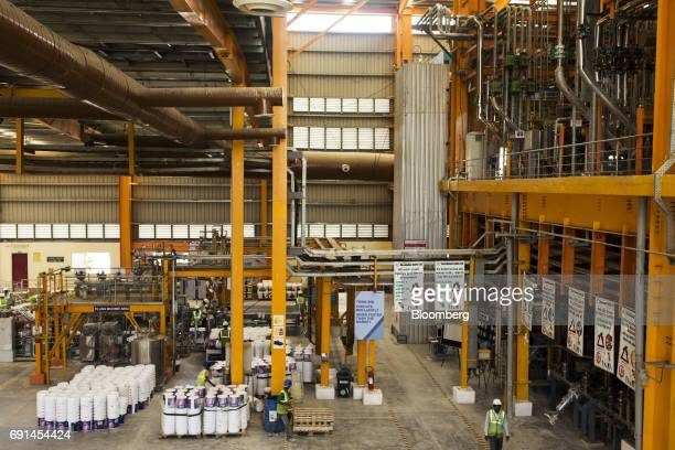 Workers walk inside an Akzo Nobel India Ltd paint factory in Gwalior Madhya Pradesh India on Thursday June 1 2017 Akzo Nobel NV rejected PPG...