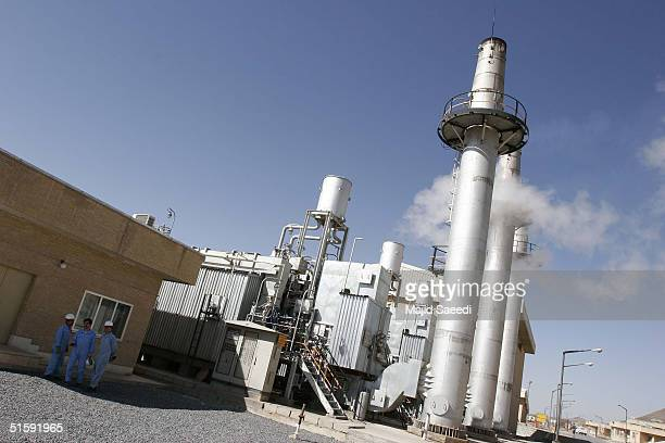 Workers walk outside Iran's controversial heavy water production facility October 27 2004 at Arak south of the Iranian capital Tehran Iran said...