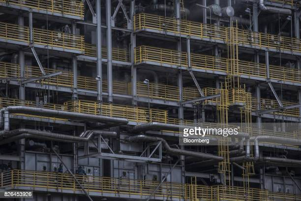 Workers walk outside the Braskem SA petrochemical plant in Duque de Caxias Brazil on Friday Aug 4 2017 Petroleo Brasileiro SA and Odebrecht SA...