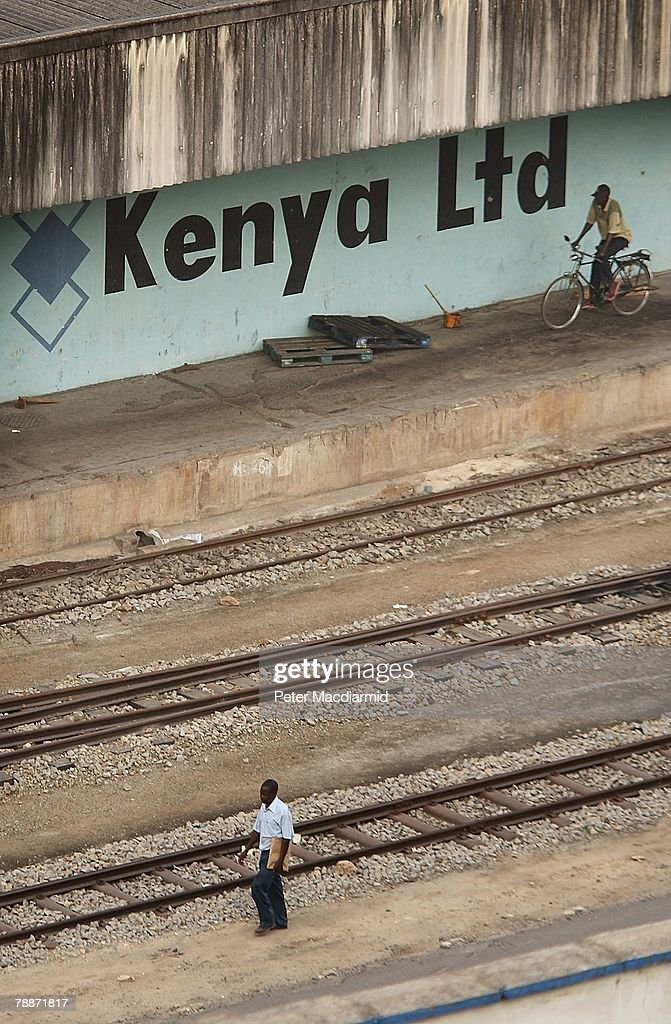 Workers walk the railway tracks at Mombasa port on January 10, 2008 in Kenya. Tourism is a $1 billion industry in Kenya. Some tour operators have temporarily banned package holidays over fear of post election violence.