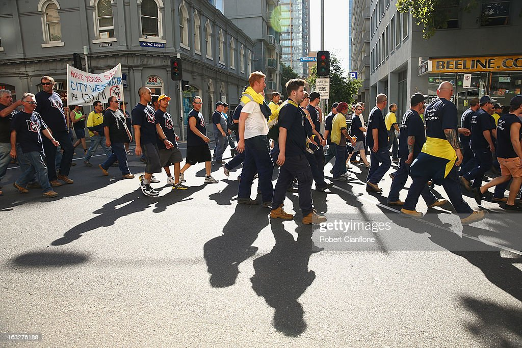 Workers walk through the city during a union organised protest against temporary worker (457) visas on March 7, 2013 in Melbourne, Australia. As Australia heads towards a Federal Election in September the row over 457 Visas is escalating, with Prime Minister Gillard vowing to tighten the guidelines, which has led Greens leader Christine Milne to accuse the PM of dog whistling.