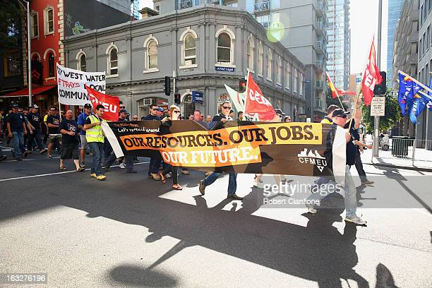 Workers walk through the city during a union organised protest against temporary worker visas on March 7 2013 in Melbourne Australia As Australia...