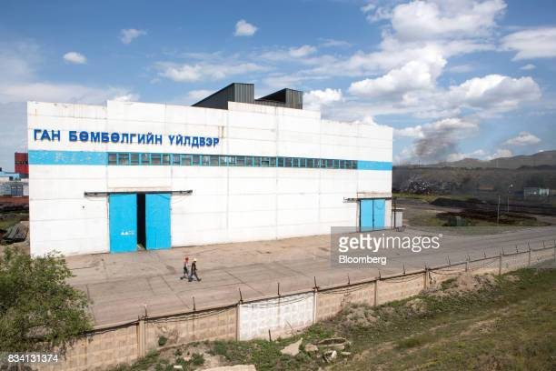 Workers walk through the Darkhan Metallurgical Plant in Darkhan Mongolia on Monday Aug 14 2017 Mongolia desperate to make more of its abundant...