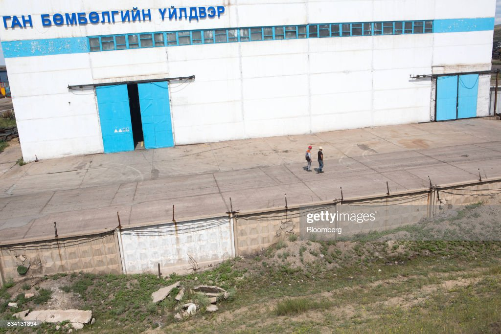 Workers walk through the Darkhan Metallurgical Plant in Darkhan, Mongolia, on Monday, Aug. 14, 2017. Mongolia, desperate to make more of its abundant resources as it seeks to revive its flailing economy, aims to make that vision a reality through one of the world's most ambitious power projects. The landlocked nation is considering a $7 billion plan to build coal, wind and solar plants that could send electricity across China, Russia, South Korea and Japan, according to the Shivee Energy Complex. Photograph: Taylor Weidman/Bloomberg via Getty Images