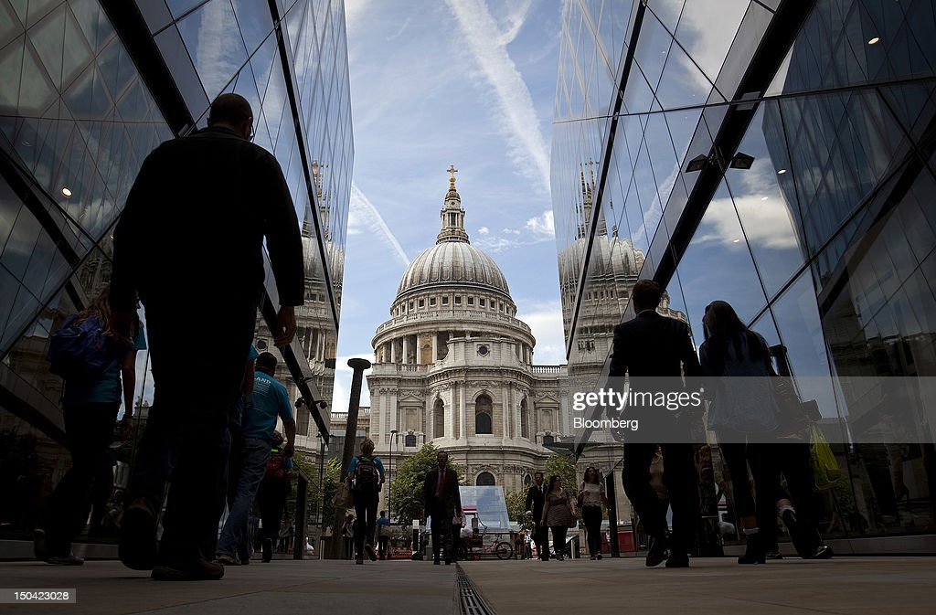 Workers walk through the One New Change shopping mall in front of St. Paul's Cathedral in London, U.K., on Friday, Aug. 17, 2012. Banks, insurers and other financial-services firms may eliminate a total of about 3,000 jobs across greater London as companies in the New York region add 9,000, according to U.K.-based researcher Oxford Economics Ltd. Photographer: Simon Dawson/Bloomberg via Getty Images