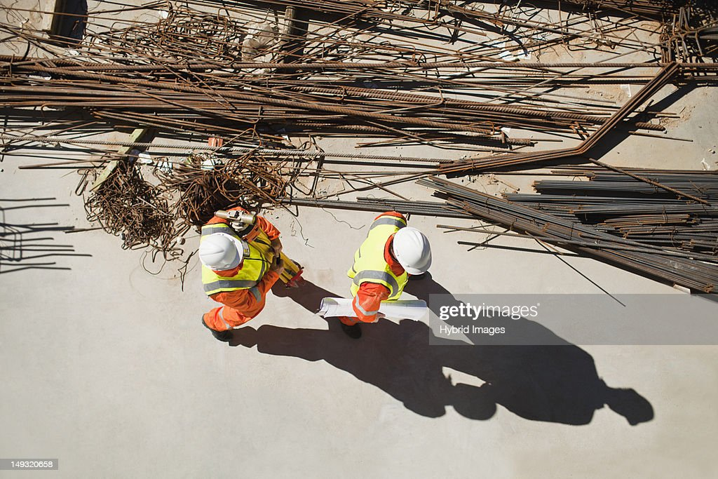 Workers walking at construction site : Stock Photo