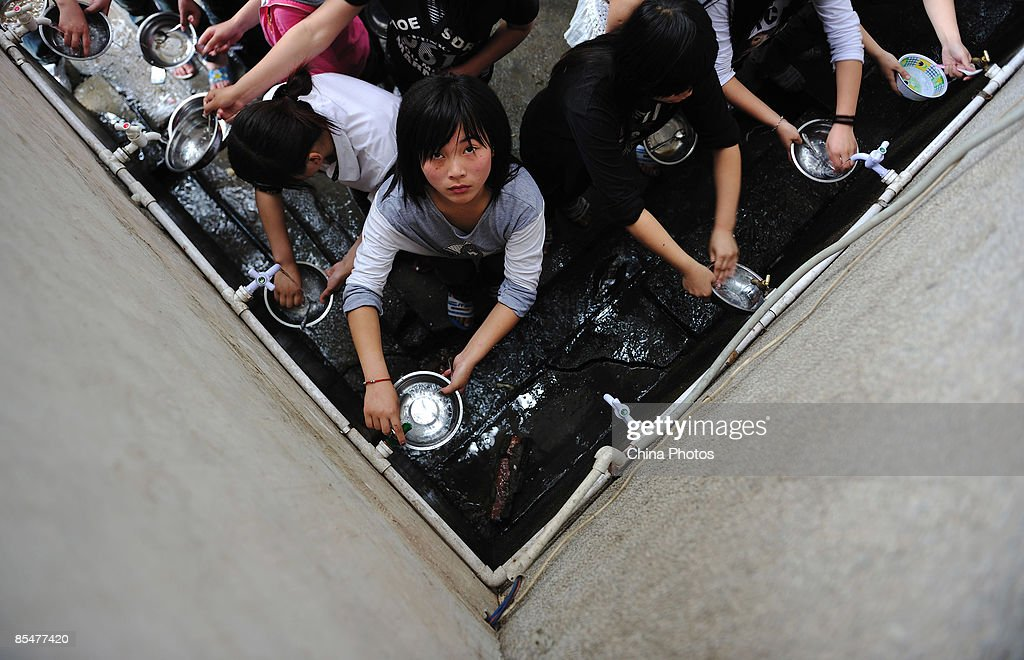 Workers wash dishes after lunch at the Shenzhen Quanshun Human Resources Co. Ltd. on February 26, 2009 in Shenzhen, Guangdong Province, China. The company, which was established by entrepreneur Zhang Quanshou, supplies workers to enterprises in the Guangdong and Fujian provinces. Since 1997 Zhang has recruited migrant workers and leased them to factories, once the production order of a company is finished workers are then transferred to another one.