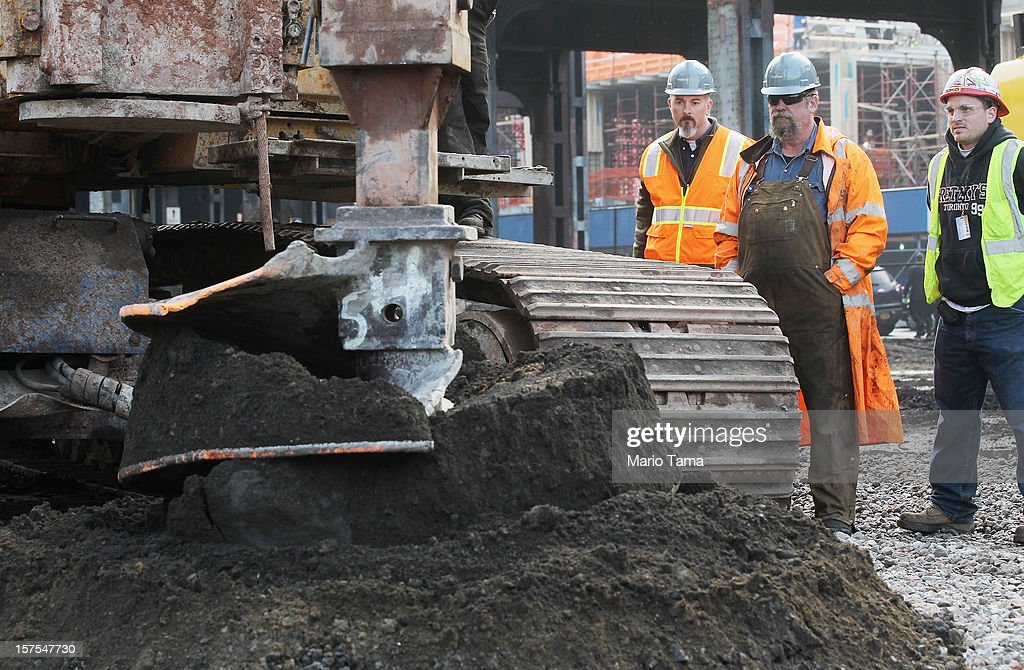 Workers watch as ground is broken at a groundbreaking ceremony for the Hudson Yards development at the site which is expected to boast 13 million square feet of residential and commercial space on a 26-acre site on Manhattan's west side on December 4, 2012 in New York City. The site was the largest undeveloped piece of property in Manhattan and is expected to create around 23,000 construction jobs. It will be the largest private development in the city since Rockefeller Center.
