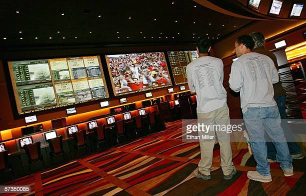 Workers watch the end of a baseball game at the race and sports book at the Red Rock Casino April 17 2006 in Las Vegas Nevada The 96foot long...