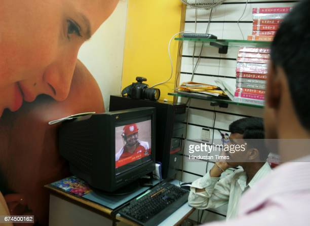 Workers watching IPL Match in Photo studio in dadar