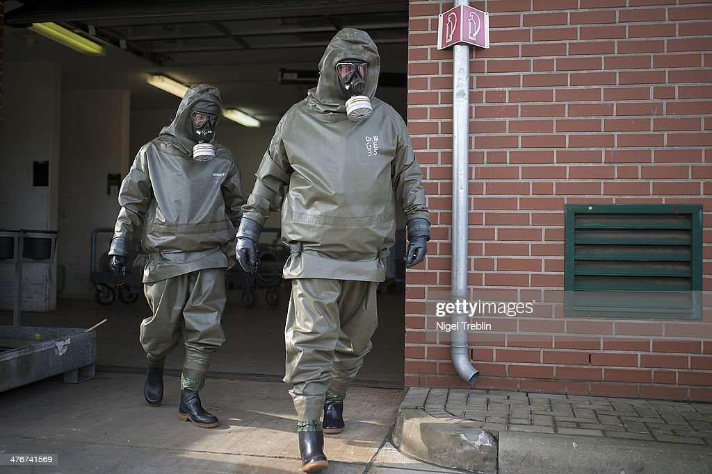 Workers wear protective clothing during a press day at the GEKA facility on March 5, 2014 in Munster, Germany. GEKA is federally-funded and its sole function is the destruction of chemical weapons from military arsenals. Syria agreed to give up its chemical weapons last August and disposal, which is already underway on an American ship in the Mediterranean, is scheduled to be completed by June.