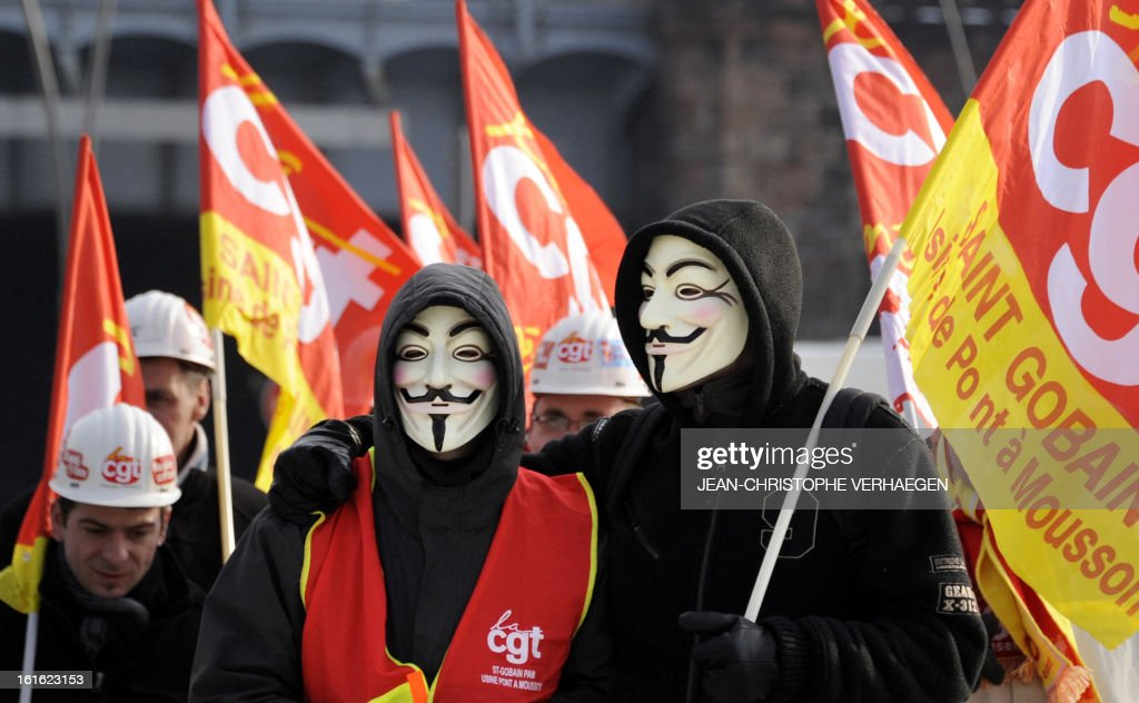 Workers wearing Guy Fawkes masks, used by the Anonymous movement, take part in a demonstration called by French CGT trade union on February 13, 2013 in Metz, eastern France, to claim for the safeguard of the local industry in the French eastern region of Lorraine.