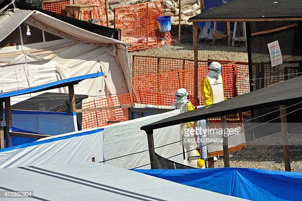 Workers wearing protective suits are pictured at the Donka Ebola treatment center on May 2 2015 in Conakry Guinea and Sierra Leone the two African...