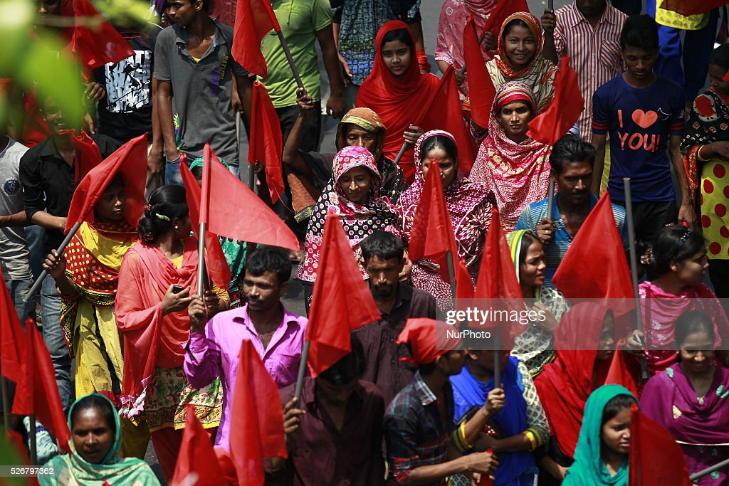Workers wearing red headbands join a procession in Dhaka marking May Day on Sunday, on May 1, 2016.