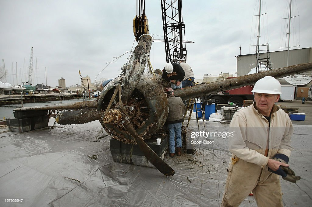 Workers with A and T Recovery prepare a WWII era FM-2 'Wildcat' Fighter plane for transport after it was recovered from Lake Michigan on December 7, 2012 in Waukegan, Illinois. The aircraft, which was recovered from 200 feet of water, crashed into the lake on December 28, 1944 when the engine died while it was on a training mission being piloted by Ensign William Forbes, who survived the crash. The aircraft, which is still owned by the U.S. Navy, will be shipped to the Naval Aviation Museum in Pensacola, Florida for restoration.