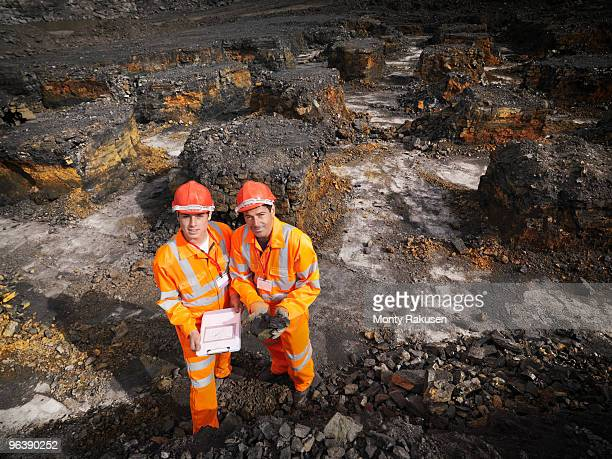 Workers With Clipboard In Coal Mine