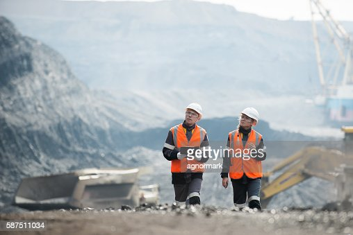 Workers with coal at open pit : Stock Photo