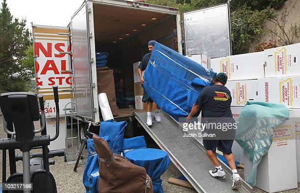 Workers with Johnson and Daly Moving and Storage move a piece of furniture into a truck while moving a family August 3 2010 in Tiburon California...