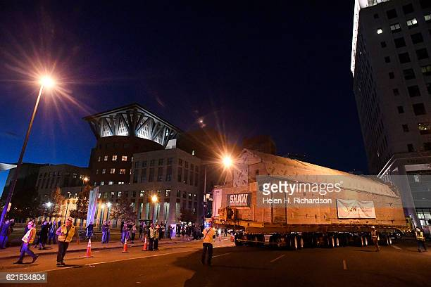 Workers with Mammoth Moving and Rigging carefully turn the 106 year old Kirkland Art Studio from East 13th avenue onto Broadway on November 6 2016 in...