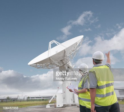 Workers with satellite dish