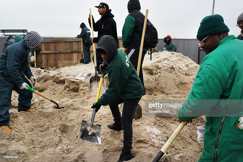 Workers with the Parks Department clean sand from a playground damaged during Hurricane Sandy in the Rockaways on January 15, 2013 in the queens borough of New York City. A $50.7 billion Superstorm Sandy aid package is expected to be voted on today in the House. The package, which has come under criticism by some fiscal conservatives, is being heavily pushed by Northeastern lawmakers. The money would be spent on immediate needs to the region including $5.4 billion for New York and New Jersey transit systems and $5.4 billion for the Federal Emergency Management Agency's disaster relief aid fund.