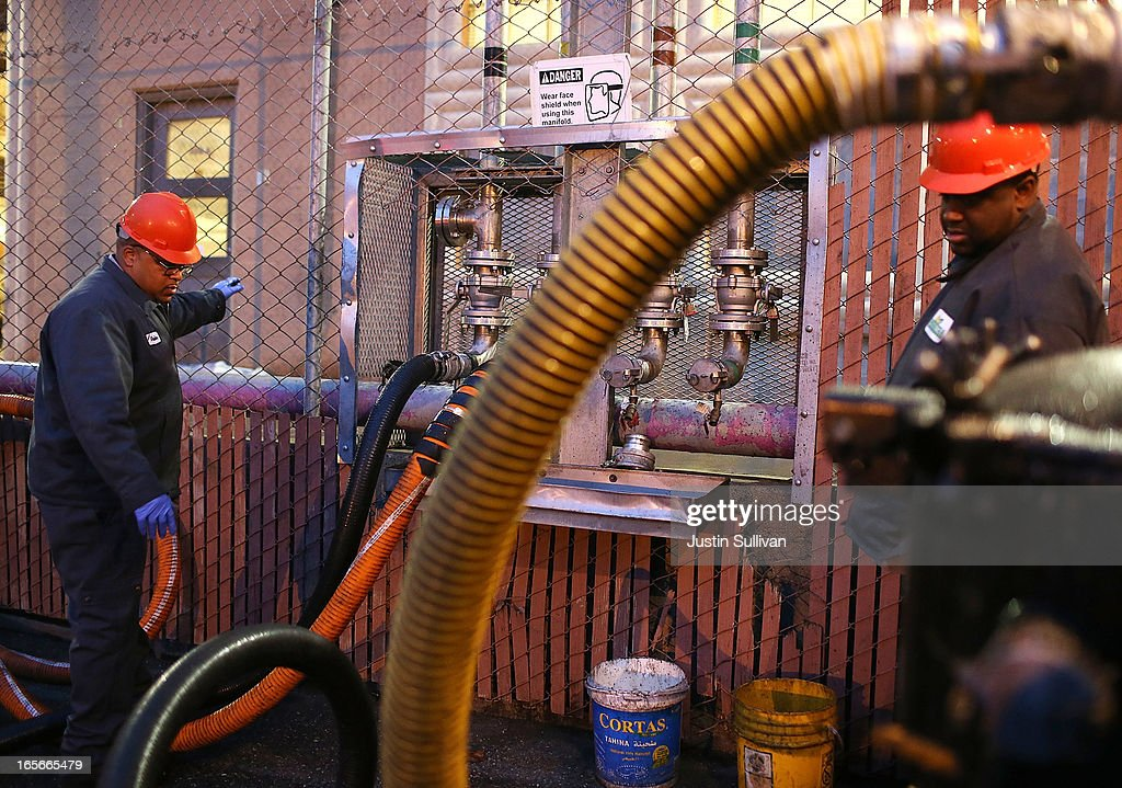 Workers with the San Francisco Water Power and Sewer's SFGreasecycle program pump used cooking oil from a truck into a tank to be filtered on April 5...