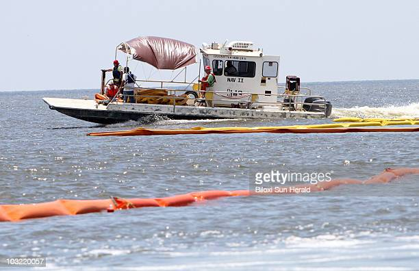 Workers with United States Environmental Services reposition booms in the Bay of St Louis in Hancock County Mississippi on Thursday May 27 as efforts...