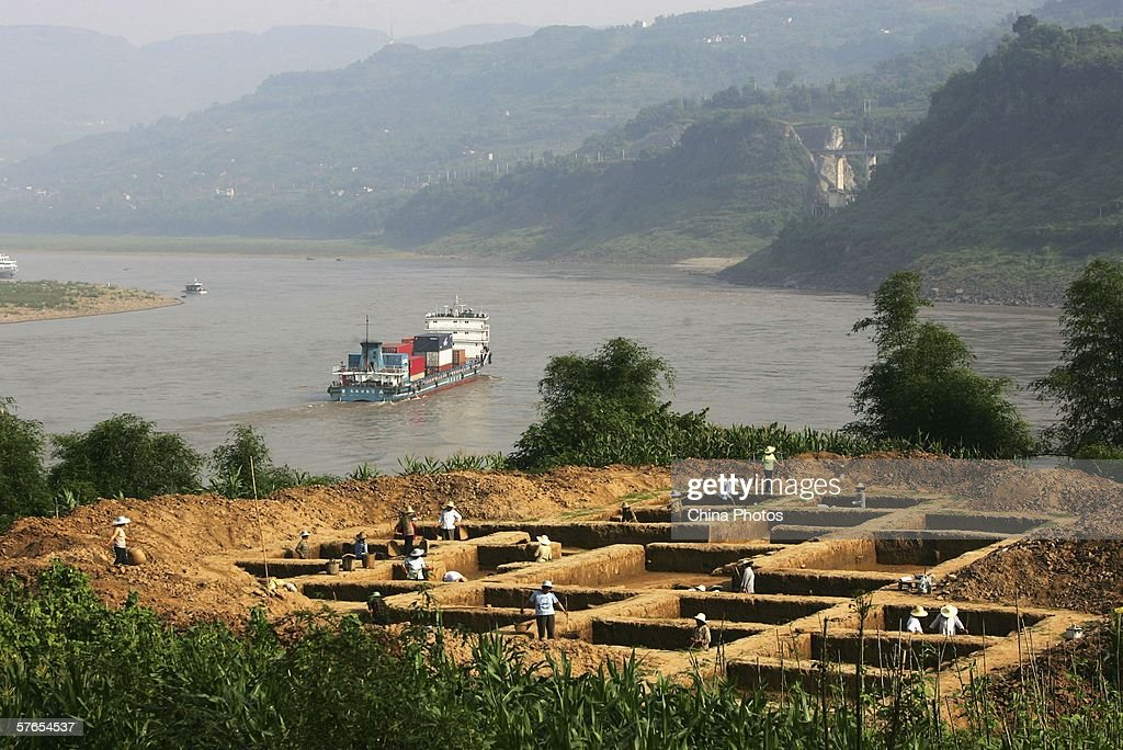 Workers work at an archaeological site which will be submerged by the Three Gorges Dam Reservoir at Tuanjie Village of Shituo Township on May 17 2006...