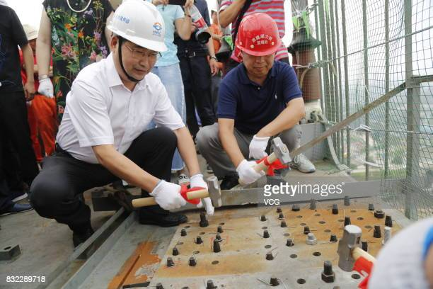 Workers work at the construction site of the 2390meterlong Dongting Lake Bridge on August 15 2017 in Yueyang Hunan Province of China The Second...