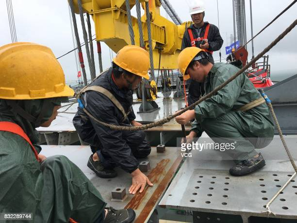 Workers work at the construction site of the 2390meterlong Dongting Lake Bridge on August 14 2017 in Yueyang Hunan Province of China The Second...