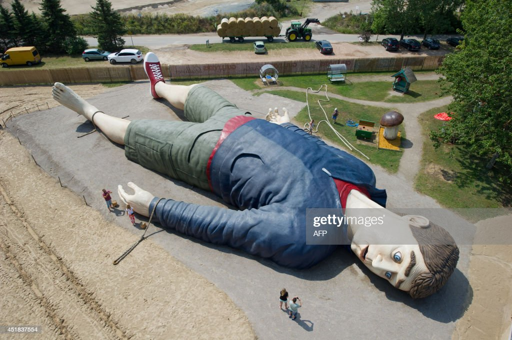 Workers work at the 'Gulliver' sculpture on July 8, 2014 in the amusement park 'Gulliver's World' in Pudagla, on the island of Usedom, Germany. The sculpture of 'Gulliver in Lilliput' is 36 meters long and 17 meters wide, which is one of the largest of its kind in Europe. The sculpture will be shown from July 11, 2014.