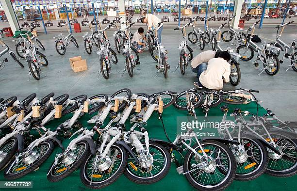 Workers work on electric bicycles in Repow electric vehicles factory on September 17 2007 in Jinhua Zhejiang province China