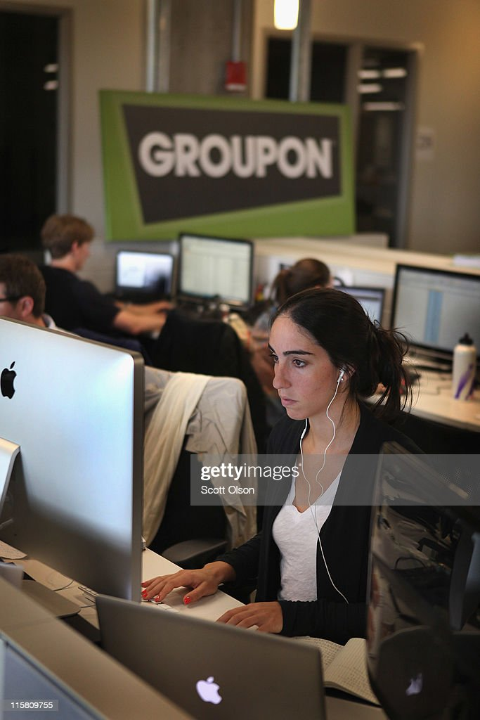 Workers work on projects at Groupons international headquarters on June 10, 2011 in Chicago, Illinois. Groupon, a local e-commerce marketplace that connects merchants and consumers by offering goods and services at a discount, announced June 2 that it had filed with the Securities and Exchange Commission for a proposed initial public offering of its Class A common stock. The company, launched in Chicago in November 2008 now markets products and services in 43 countries around the world.