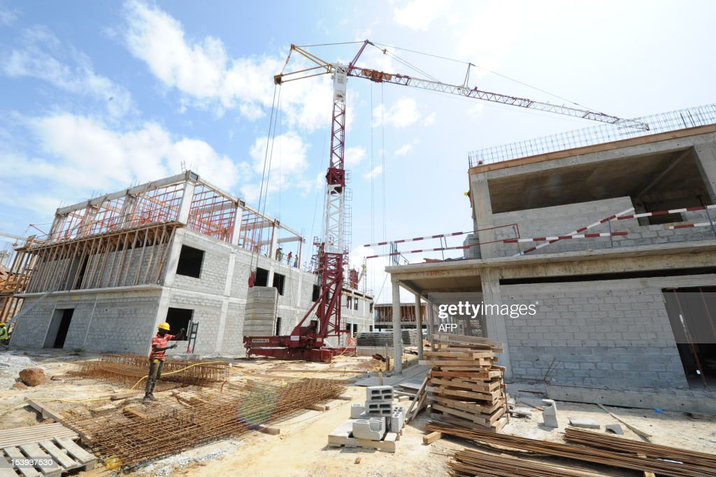 Workers work on the construction of a university hospital in Owendo port of Libreville on October 11 2012 Gabon has launched a 20 billion USD...
