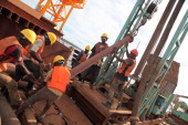 Workers work on the construction of an ultra modern bridge by a Chinese company at Kurasini area in Dar es Salaam on March 23 2013 The bridge with a...