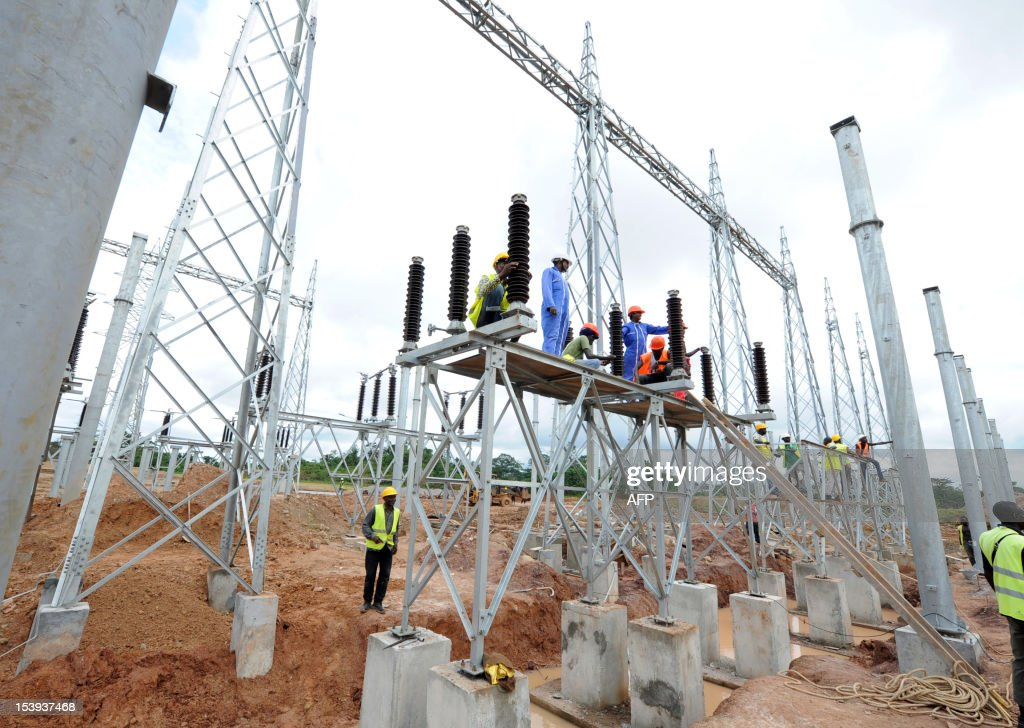 Workers work on the electrification of a special economic zone in Nkok 10kms from Libreville on October 11 2012 Gabon has launched a 20 billion USD...