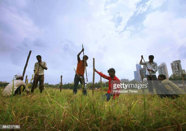Workers work on the ground for the Shiv Sena Dussehra Rally which is on 6th October at Shivaji Park Ground Dadar