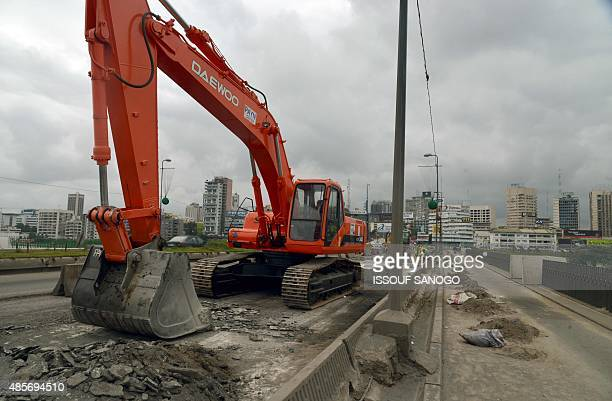 Workers work on the rebuilding site of the General de Gaulle bridge in Abidjan on August 28 2015 The government began rehabilitation works of the...